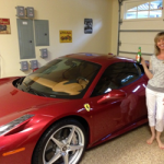 David's wife, Cheryl, posing with Alex's Ferrari... both absolutely beautiful!