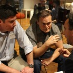 David and Tim mentor a founder at HQ Raleigh during the Venture Hacked event
